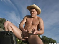 Sexy bodied country guy Brad Star strokes the sperm out of his big dick in the open air