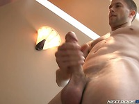 Naked stud Brec Boyd stands still and strokes his hard dick with passion
