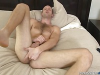 Naked guy Brent Biscayne touches his ass, balls and dick on the bed masturbating