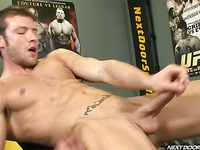 Hot bodied Kevin Crows jerks his dick like crazy at the gym after workout