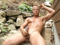 Completely naked muscular village guy Matthew F plays with his prick outdoors