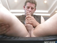 Rod Spunkel jerks his big cock on the couch before showing a self blowjob trick