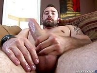 Tattooed muscled man Vinny Castillo with a beard jerks off in the bedroom