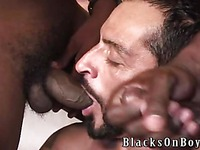 Hairy tattooed gay man Tom Colt satisfies his sexual needs and desires with black gay guy