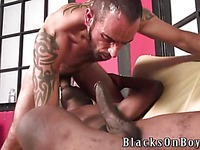 Tattooed white man Tom Colt gets naked and swallows black sausage eagerly