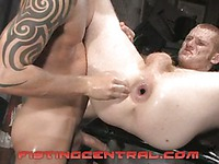 Tattooed gay guy Andre Barclay fists Ryan Patrick's sexy gay butt with no mercy