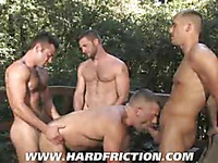 Four hairy gay men Brandon Lewis, Bruno Bond, Morgan Black and Sean Stavos fuck together outdoors