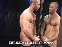 Hairy chested hunk Junior Stellano fingers his asshole and jerks his dick in front of the mirror
